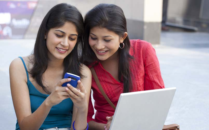 college-students-using-mobile-stock-image